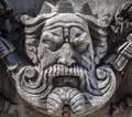 Stone king the face of a carved in on the facade of a building Stock Photography