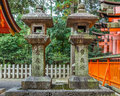 Stone lantern at fushimi inari taisha shrine in kyoto the main structure was built reachable by a path lined with thousands of Stock Photo