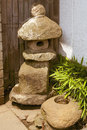 Stone lantern traditional small near japanese house Stock Photos