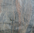 Stone layered texture atlantic beach close up Stock Photography