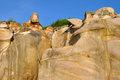 Stone like human head and face weathering decayed granite under blue sky in fujian south of china of Stock Photo