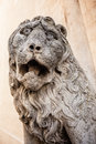 Stone lion ancient sculpture of a fierce roaring over a wall Stock Images