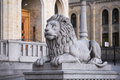 Stone lion on the background of the parliament in oslo norway Royalty Free Stock Image