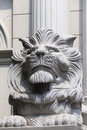 Stone lion in front of the building Royalty Free Stock Images