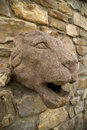 Stone lion head on a wall Stock Photo