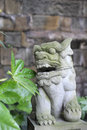 Stone Lion With Moss