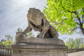 Stone lion statue on Tuileries embankment Royalty Free Stock Photo