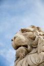 Stone lion under sky statue of a a nice blue Royalty Free Stock Photography