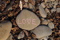 Stone love pink drawn text on grey color Royalty Free Stock Photos
