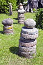 Stone and millstone collection in the yard Stock Image