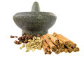 Stone mortar and spices ii a group of cardamom star anise cinnamon stick with a Stock Photography