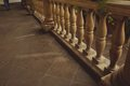 Stone parapet on the sidewalk tiles shade and Royalty Free Stock Photos