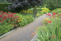 Stone path in blooming garden english Stock Images