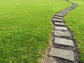 Stone path in grass the park Stock Photo