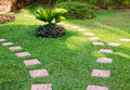 Stone path on green grass Stock Photo