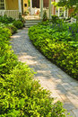 Stone path in landscaped home garden Stock Photography