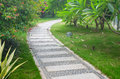 Stone path in park bending garden of Stock Images