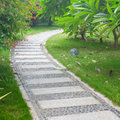 Stone path in park bending garden of Royalty Free Stock Images