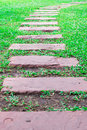 Stone path way pathway on green grass Royalty Free Stock Photo