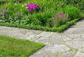 Stone paths in a flowering garden crossing summer Stock Photography