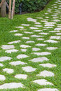 Stone pathway in the garden decorated Stock Photography