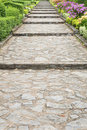 Stone pathway pass through a garden Stock Photos