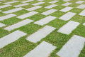 Stone pave background decorated on grass Royalty Free Stock Photo