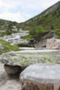 Stone picnic table in tyroler ziller valley austria near the zamser bach a mountain stream the zillertal alps this stream Stock Photo