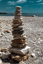 A stone pile on the sea beach. Stone tower closeup. Royalty Free Stock Photo