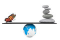 Stone pile in a Zen Garden with butterfly balanced on a Earth gl Royalty Free Stock Photo