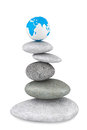 Stone pile in a Zen Garden with a Earth globe Royalty Free Stock Photo