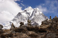 Stone piles and great mountains on ridge in front of snow covered himalayan Stock Photography
