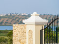 Stone pillar of luxury villa gates with a river and olive trees in the back ground Stock Photography