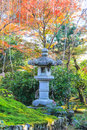 Stone post covered by color of nature in japan Royalty Free Stock Photo