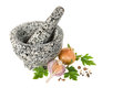 Stone pounder with spices on a white background Royalty Free Stock Photography