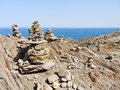 Stone pyramids on Cap de Creus natural park, Spain Royalty Free Stock Photo