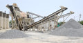 Stone quarry making of crushed at in winter Stock Images
