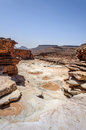 Stone river and waterfall in the dry season, Draa valley (Morocc Royalty Free Stock Photo