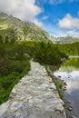Stone road near the lake in mountains Stock Photo