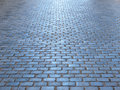 Stone road paved block with reflection of the light heading infinity Stock Photos