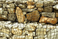 Stone in rope mesh at beach Royalty Free Stock Photo
