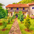 Stone rural house with pretty cottage garden Royalty Free Stock Photo
