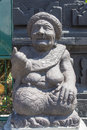 Stone sculpture representing the old woman bali indonesia Stock Image