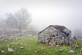 Stone shed in mountain with fog the Stock Photos