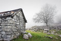 Stone shed in mountain and a tree Royalty Free Stock Photos