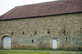 Stone shed with tile roof in french village france Stock Photography