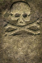 Stone skull crossbones ancient weathered and Stock Photos