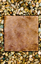 Stone slab surrounded by grungy pebbles Royalty Free Stock Images