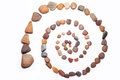 Stone spiral made from the pebbles isolated on the white Stock Image