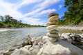 Stone stack of pebbles on the banks of a river Royalty Free Stock Photo